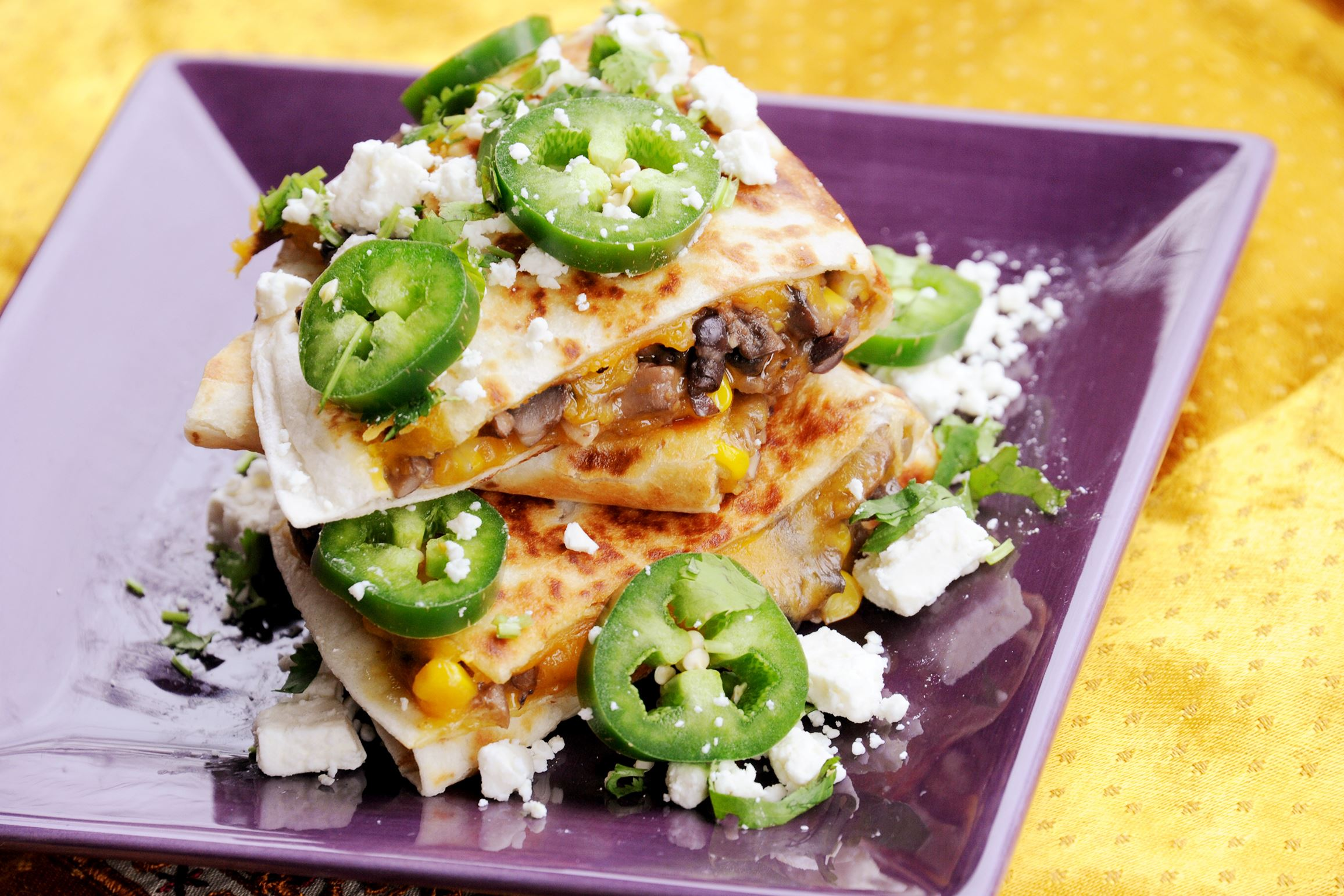 20170330lf-Lent03-1 St. Rita Quesadillas are filled with mushroom, onion, black beans, corn and cheddar cheese, and topped with feta, cilantro and jalapeno slices.