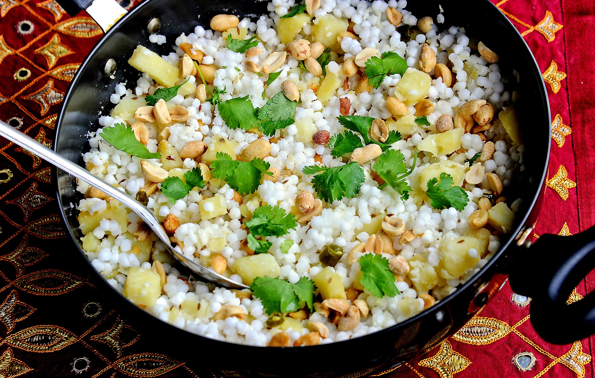 20170330lf-Lent02 Sabudana khichdi is made with tapioca pearls, cubed potatoes, peanuts, green chilies and lime juice, garnished with cilantro.