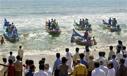 Fishermen leave the shore aboard their new boats at Kanathur Reddikuppam in the outskirts of Madras, India, in March 2005. Around 30 fishermen of this village received new boats and nets as part of a tsunami rehabilitation program by Rotary International following the Christmas 2004 tsunami.