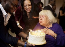 Vivian Hewitt, 97, blows out her candles.