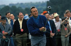Arnold Palmer hits a shot during the Masters in 1968.