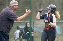 Shaler's Lauren Miller high fives coach Skip Palmer as she rounds the bases after her home run earlier this season. Palmer, who said he was retiring after this season, finished with 199 victories after a playoff loss to Baldwin Wednesday.