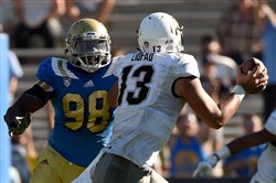 UCLA's Takkarist McKinley chases Colorado QB Serfo Liufau during an October 2015 game in Pasadena, Calif.