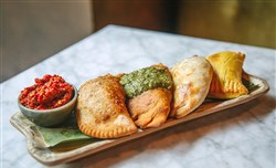 A dish of the various  hand-made empanadas at the Caribbean-themed Pirata restaurant Downtown.