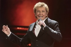 "In this March 17, 2016 file photo, Barry Manilow performs in concert during his ""One Last Time! Tour 2016"" in Hershey, Pa. Manilow tells People magazine that he hid being gay for decades because he thought he would be ""disappointing fans if they knew."" The 73-year-old music legend married his longtime manager, Gary Kief, in a 2014 ceremony at their home in Palm Springs, Calif."