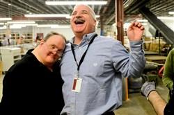 Steven Fekete, left, gives a hug to Tim Miller, center, at the Westmoreland County Blind Association in Greensburg.