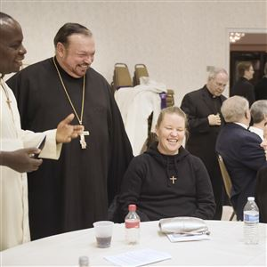 From left, Lutheran Father Jean Luzolo, a missionary from the Congo, and Father Tom Schafer, from St. John Chrystostom Byzantine Catholic Church, joke with Erin Martin, from St. John de la Salle Church in Delmont, and Sister Carrie, from Clelian Heights in Greensburg, at an evening of repentance between Lutherans and Catholics to commemorate the 500th anniversary of the Protestant Reformation at the St. John the Baptist Byzantine Catholic Cathedral on Tuesday, April 4, 2017 in Munhall.