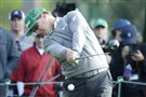 Charley Hoffman tees off on the 18th hole in the first round of the Masters on his way to a 7-under 65 and 4-shot lead.