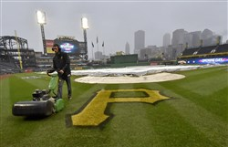 Assistant groundskeeper Evan Mascitti mows the infield at PNC Park in preparation for opening day against the Braves Friday.