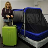 Rose Morris shows off the Safety Sleeper and the storage/travel suitcase.