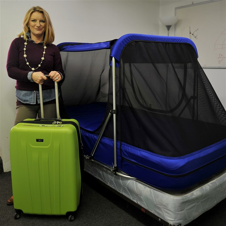 20170406ppSafetySleeper2BIZ-1 Rose Morris shows off the Safety Sleeper and the storage/travel suitcase.