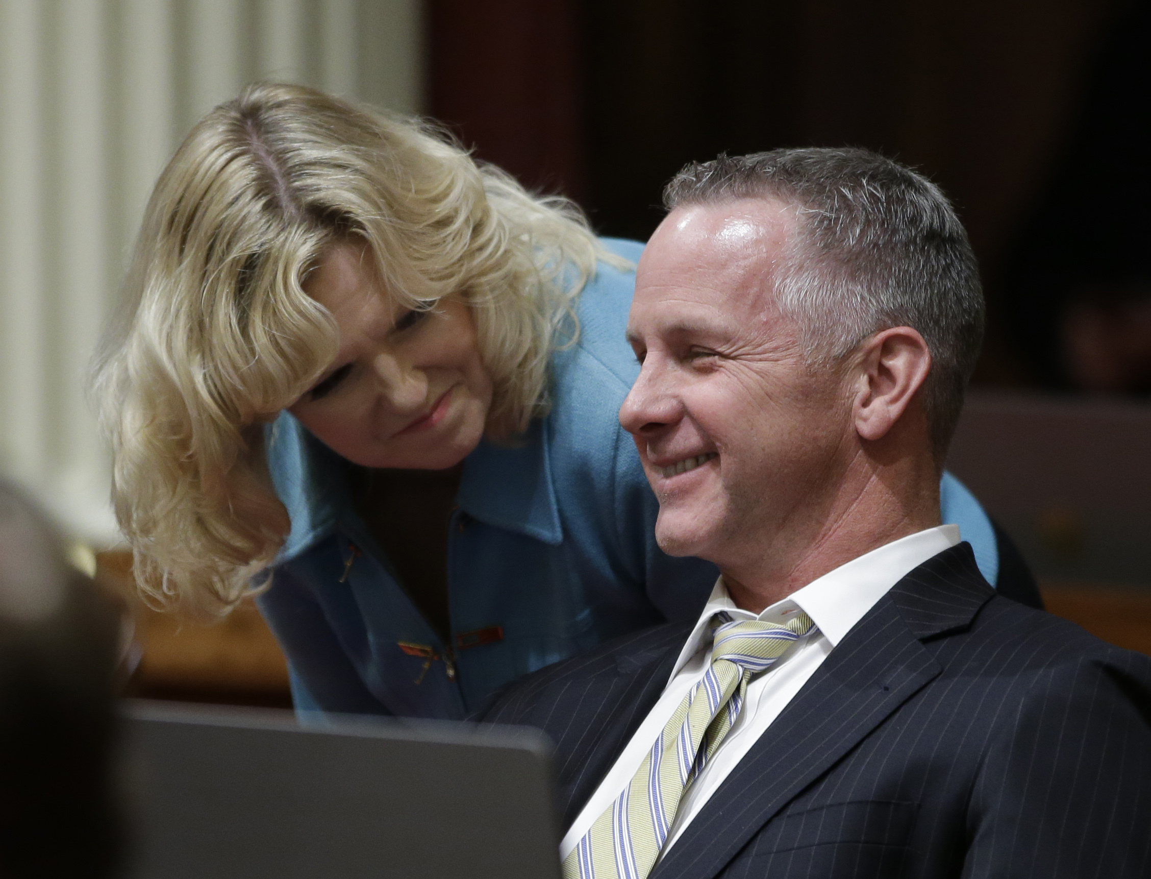 California Road Repairs State Sen. Anthony Canella, R-Ceres, smiles as he talks with Sen. Cathleen Galgiani, D-Stockton, as lawmakers debate a transportation bill, that would increase the state's gas and vehicle taxes $5 billion-a-year- to pay for major road repairs, Thursday, April 6, 2017, in Sacramento, Calif. Cannella joined Democrats in voting for the bill, SB1, that was approved and sent to the Assembly. (AP Photo/Rich Pedroncelli)