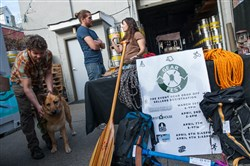 Gear Fest co-founder Christine Iksic talks to volunteers David Steakhouse, center, and Scott Ferrari as they collect used outdoors gear earlier this month. It will be sold on consignment at Gear Fest Sunday at the Ace Hotel in East Liberty.