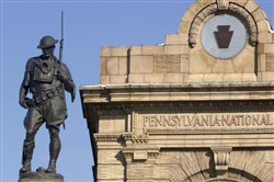 Sculptor Allen George Newman's World War I doughboy statue on the Sixth Ward Honor Roll memorial has been guarding the entrance to Lawrenceville at the intersection of Penn Ave. and Butler St. since 1919.