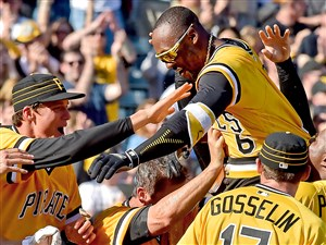 Starling Marte is hoisted into the air by his teammates after hitting a walk-off home run against the Braves in the 10th inning April 9 at PNC Park.