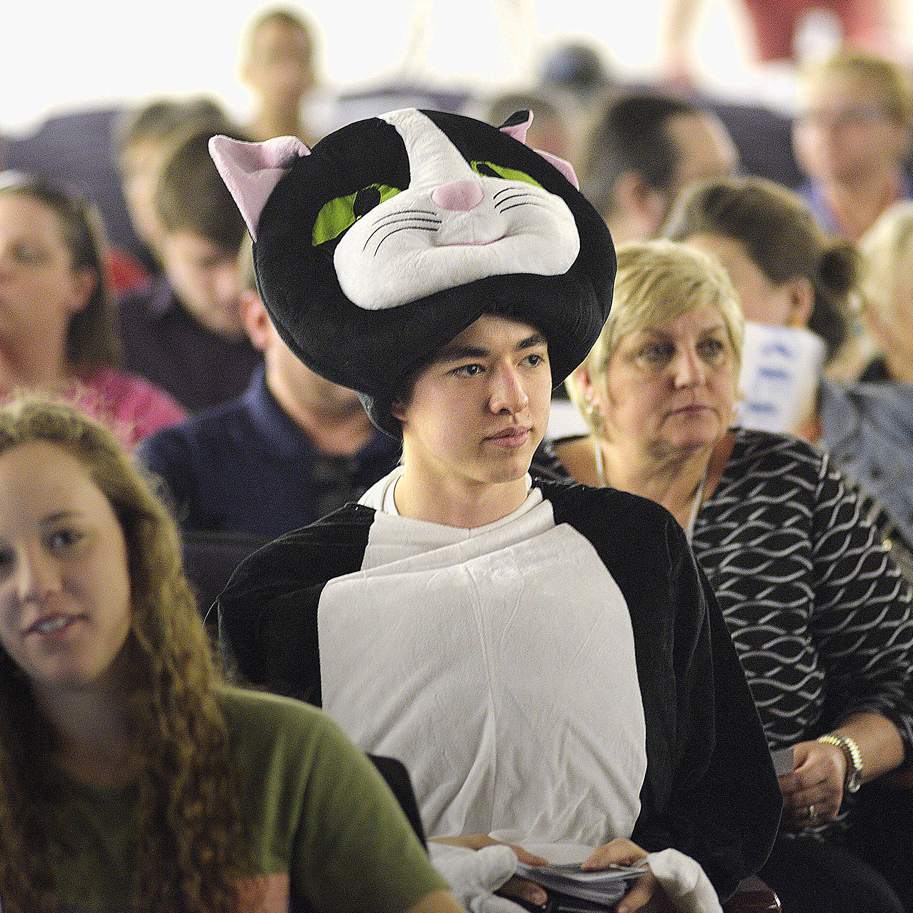 """WEB 20170409lrsencaseytownhall01 Darwin Leuba, of O'Hara, and a member of Yinzers Against Jagoffs, waits in his suit for the town hall to begin. Mr. Leuba described the costume as Republican Sen. Pat Toomey as """"Senator Scaredy Pat, the Washington Fat Cat."""""""