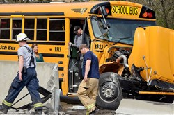 Investigators work the scene of Monday's fatal crash on Route 22 in Derry. Deborah Bopp, who was driving the school bus, was killed after the bus was hit from behind by a coal truck. The cause of the crash is still under investigation. The bus slowing down to pick up its first student when it was hit.