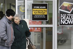 A man and a woman leave an HH Gregg store in Mayfield Heights, Ohio.