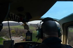 In this 2017 photo, Jack Jarrett, left, data collection specialist and Winston Chelf, chief pilot, both of Chesapeake Bay Helicopters, fly by natural gas and other industrial sites during a demonstration of new leak detection technology.