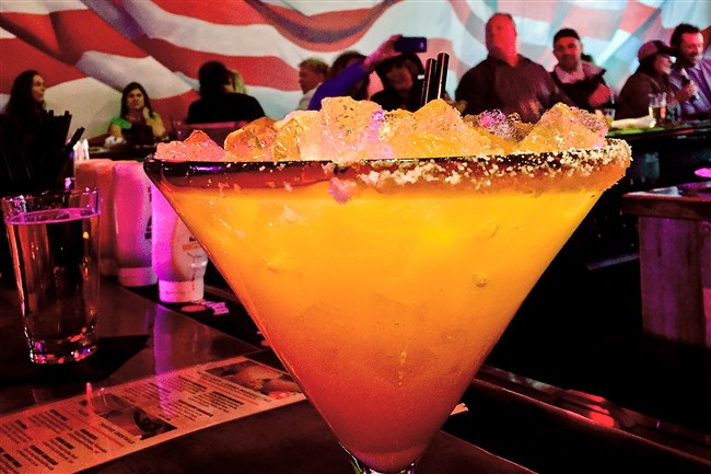 A massive mango margarita at Tequila Cowboy, North Shore.