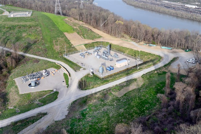 An EQT Corp. natural gas compressor station is located next to the Monongahela River in Forward.