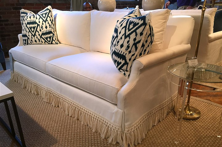 fringe gallas sofa Highland House showed its Gallas sofa from the Bungalow Classic collection with a twisted tassel fringe along the skirt.