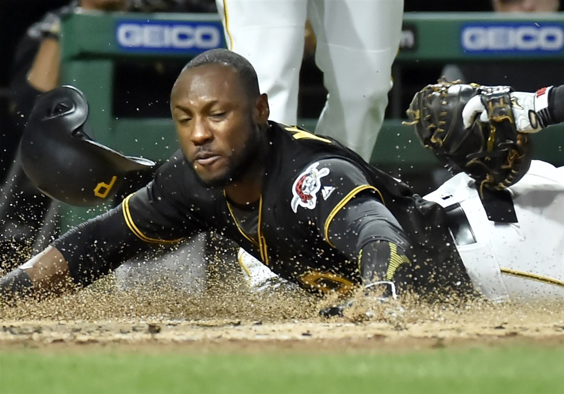 Starling marte photos photos cincinnati reds v pittsburgh pirates - Pirates Outfielder Starling Marte Steals Home By Sliding Under The Tag Of Reds Catcher Tucker Barnhart