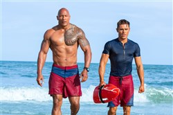 "Dwayne Johnson, left, as Mitch Buchannon and Zac Efron as Matt Brody in  Baywatch.""   The film hits theaters on May 25."