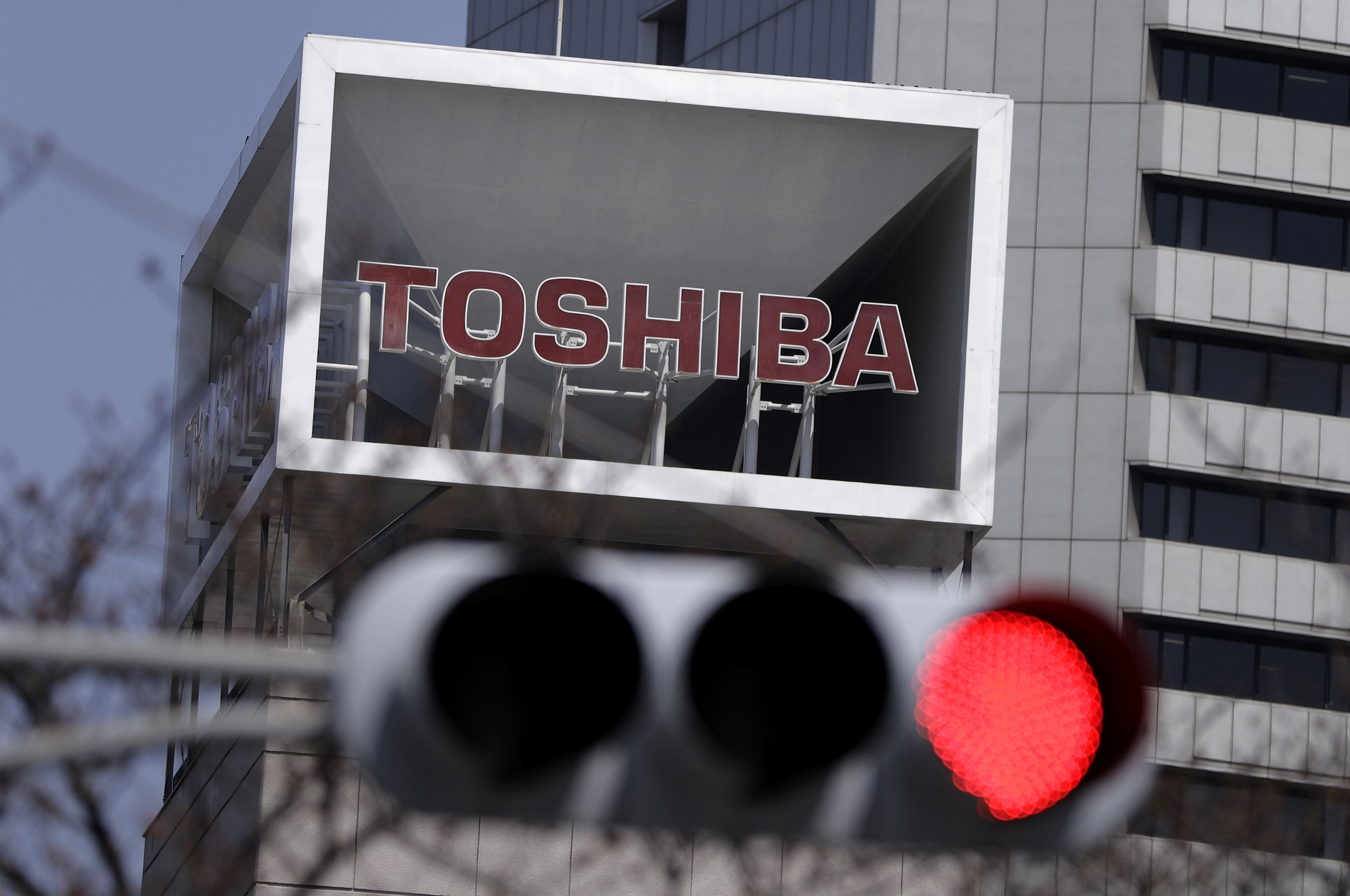 TOSHIBA-BG A Toshiba sign is displayed atop the company's headquarters in Tokyo on March 28, 2017.