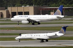 In this July 8, 2015, file photo, United Airlines and United Express planes prepare to takeoff at George Bush Intercontinental Airport in Houston.