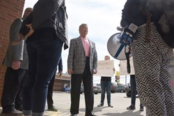 Activists trying to change the conversation about immigration in Pennsylvania voice their concerns to state Rep. Tony DeLuca, D-Penn Hills, Thursday in front of his office in Penn Hills.