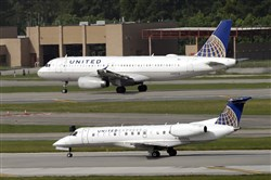 In this July 8, 2015, file photo, United Airlines and United Express planes prepare to takeoff at George Bush Intercontinental Airport in Houston. After a man is dragged off a United Express flight on Sunday, April 9, 2017, United Airlines becomes the butt of jokes online and on late-night TV.