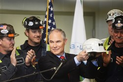"EPA administrator Scott Pruitt received an honorary Consol hard hat with his name and the inscription ""Make America Great Again"" after he thanked the miners for their work Thursday."