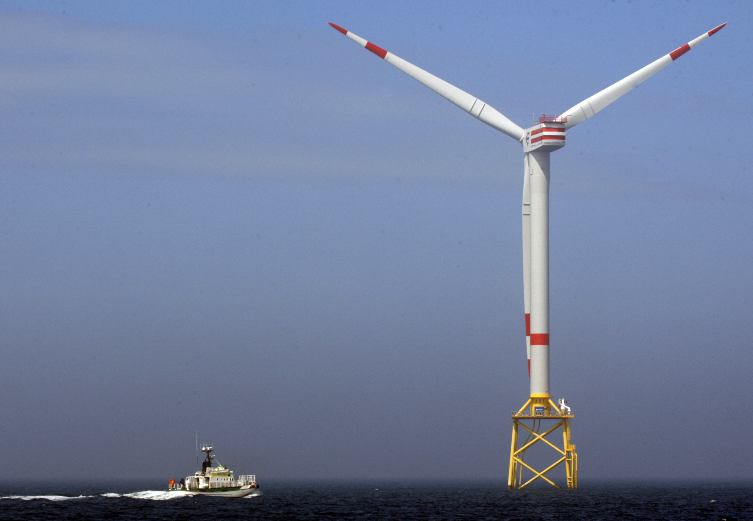 Germany Wind Power FILE - In this April 26, 2010 file photo a boat approaches a German windmill offshore power plant in the North Sea, 45 km off the coast of Norddeich. (AP Photo/Frank Augstein, file)