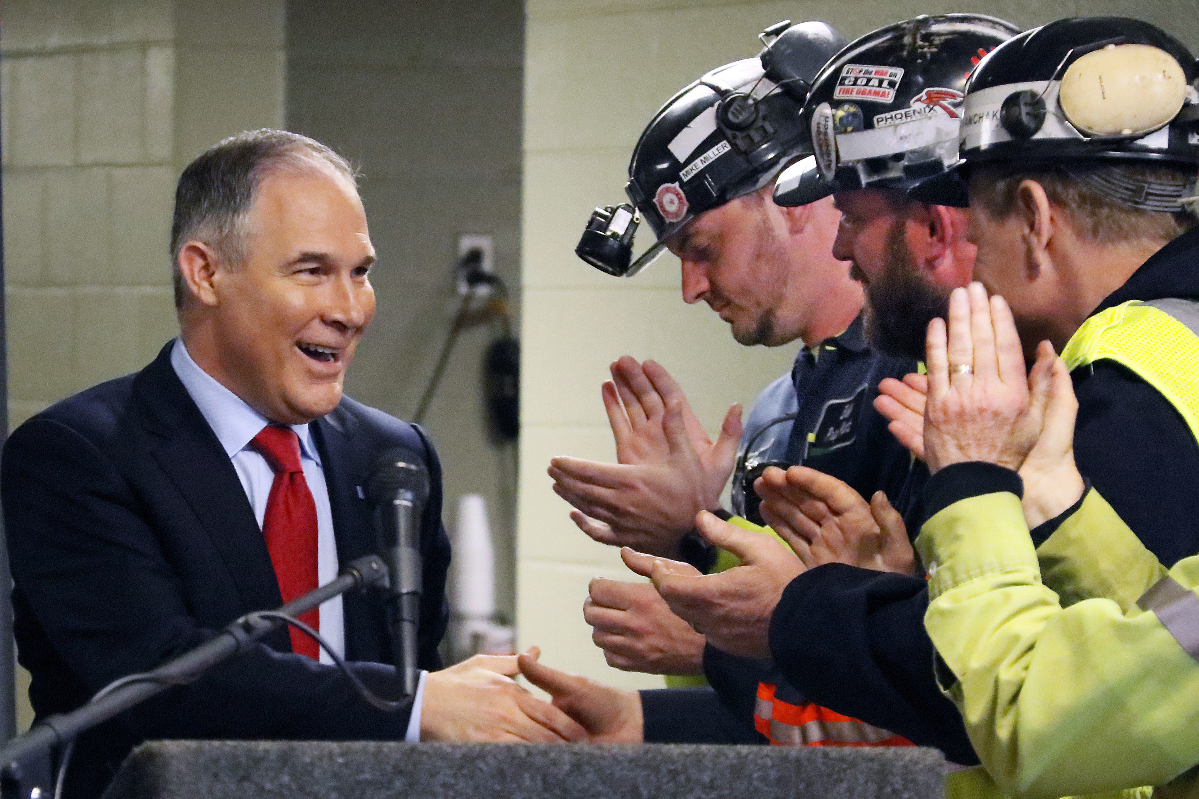 Pruitt EPA Coal Mine-2 U.S. Environmental Protection Agency Administrator Scott Pruitt, left, shakes hands with coal miners during a visit to Consol Pennsylvania Coal Company's Harvey Mine in Sycamore, Pa., Thursday, April 13, 2017. (AP Photo/Gene J. Puskar)