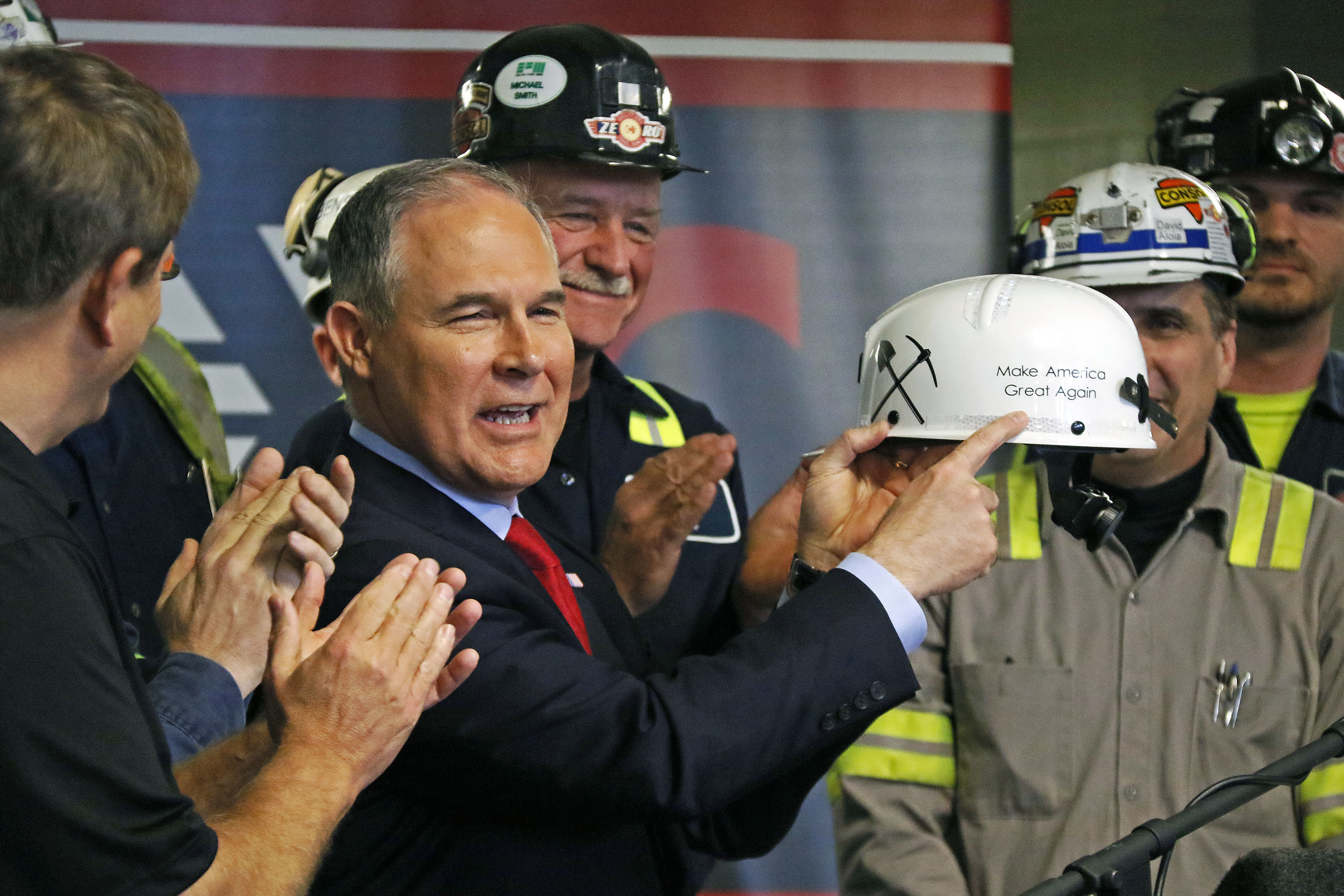 Pruitt EPA Coal Mine U.S. Environmental Protection Agency Administrator Scott Pruitt holds up a hardhat he was given during a visit to Consol Pennsylvania Coal Company's Harvey Mine in Sycamore, Pa., Thursday, April 13, 2017. (AP Photo/Gene J. Puskar)