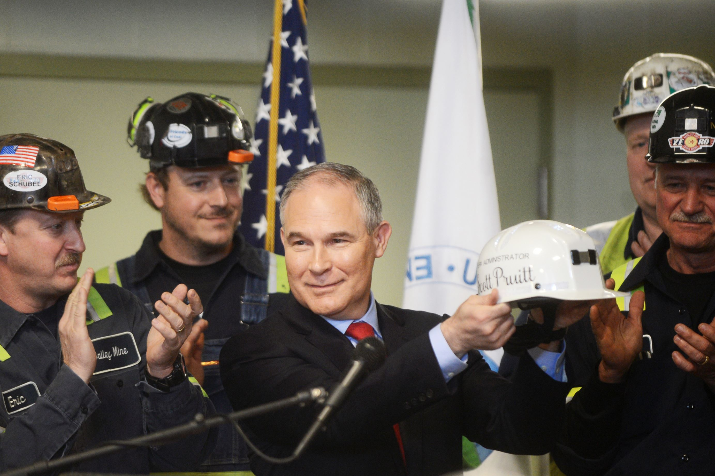 """20170413ng-Pruitt5-1 EPA administrator Scott Pruitt received an honorary Consol hard hat with his name and the inscription """"Make America Great Again"""" after he thanked the miners for their work Thursday."""