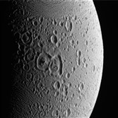 In an undated handout photo, the surface of Enceladus, a moon orbiting Saturn. New findings from data collected by NASA's Cassini spacecraft suggest that icy moons like Enceladus could be the home to microbes or other life-forms.