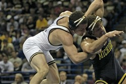 Pitt's Keith Gavin, left, wrestling at the NCAA national championships in 2008.