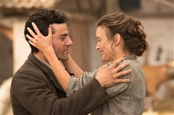 "Oscar Isaac and Charlotte Le Bon in ""The Promise."""