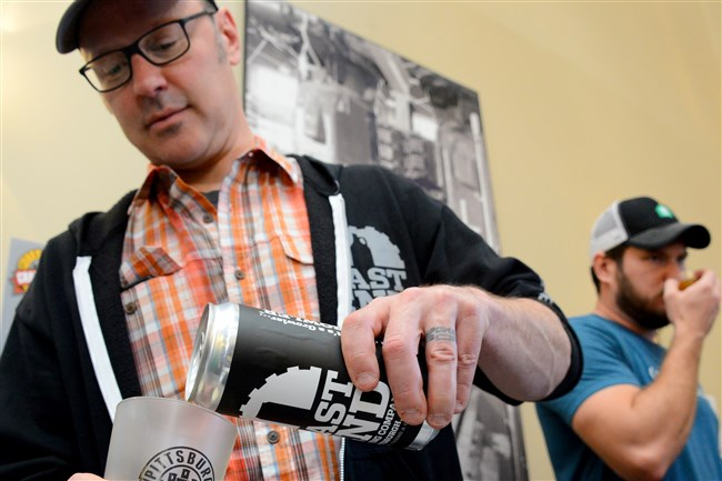 Scott Smith of East End Brewing pours a beer at Penn Brewery Restaurant.