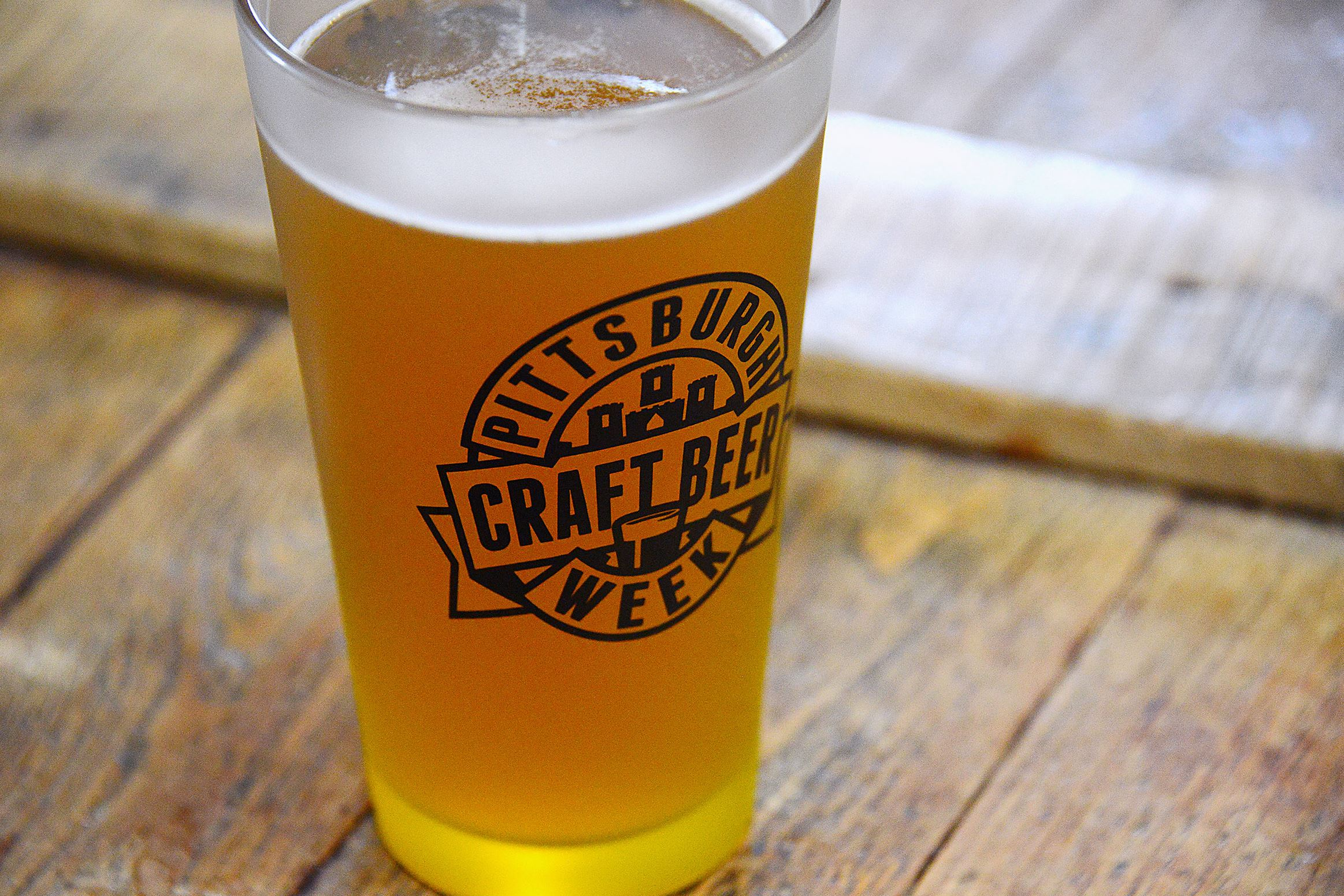 20170415lf-Brew01-1 A beer sits on a barrel. The sixth year for Pittsburgh Craft Beer Week, a celebration of the local industry at venues across the city and region runs April 21-30.