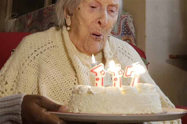 Emma Morano blows candles on Nov. 29, 2016, the day of her 117th birthday in Verbania, Italy.