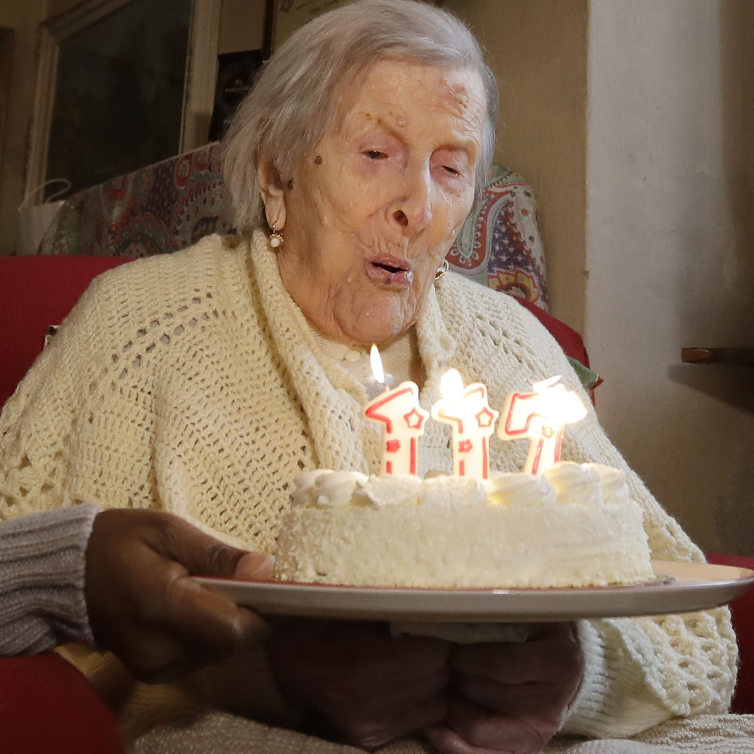 Italy World's Oldest Person-2 Emma Morano blows candles on Nov. 29, 2016, the day of her 117th birthday in Verbania, Italy.