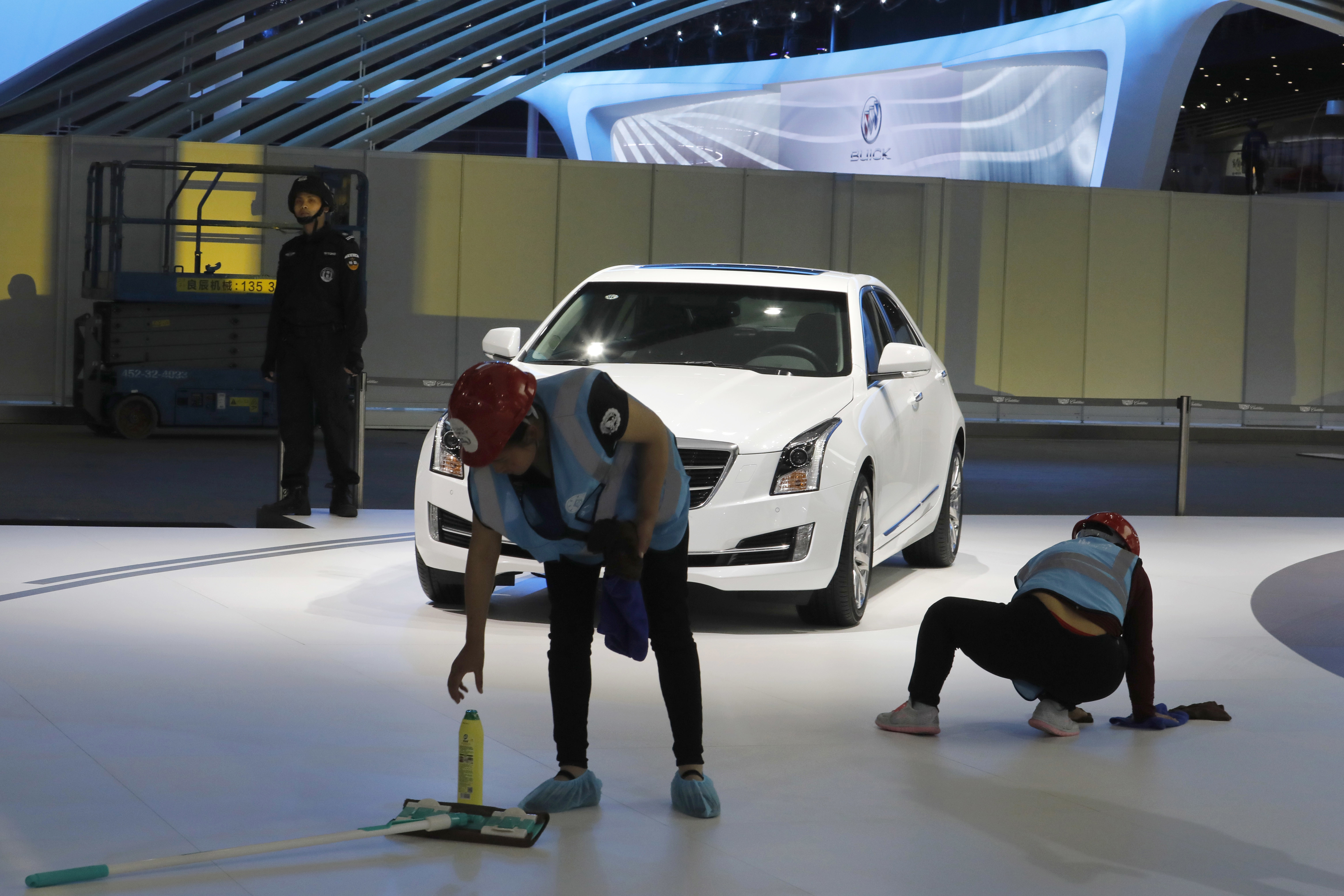 China Auto Show-1 Workers prepare for the Auto Shanghai 2017 show at the National Exhibition and Convention Center in Shanghai, China, Tuesday, April 18, 2017. At the auto show, the global industry's biggest marketing event of the year, almost every global and Chinese auto brand is showing at least one electric concept vehicle, if not a market-ready model. (AP Photo/Ng Han Guan)