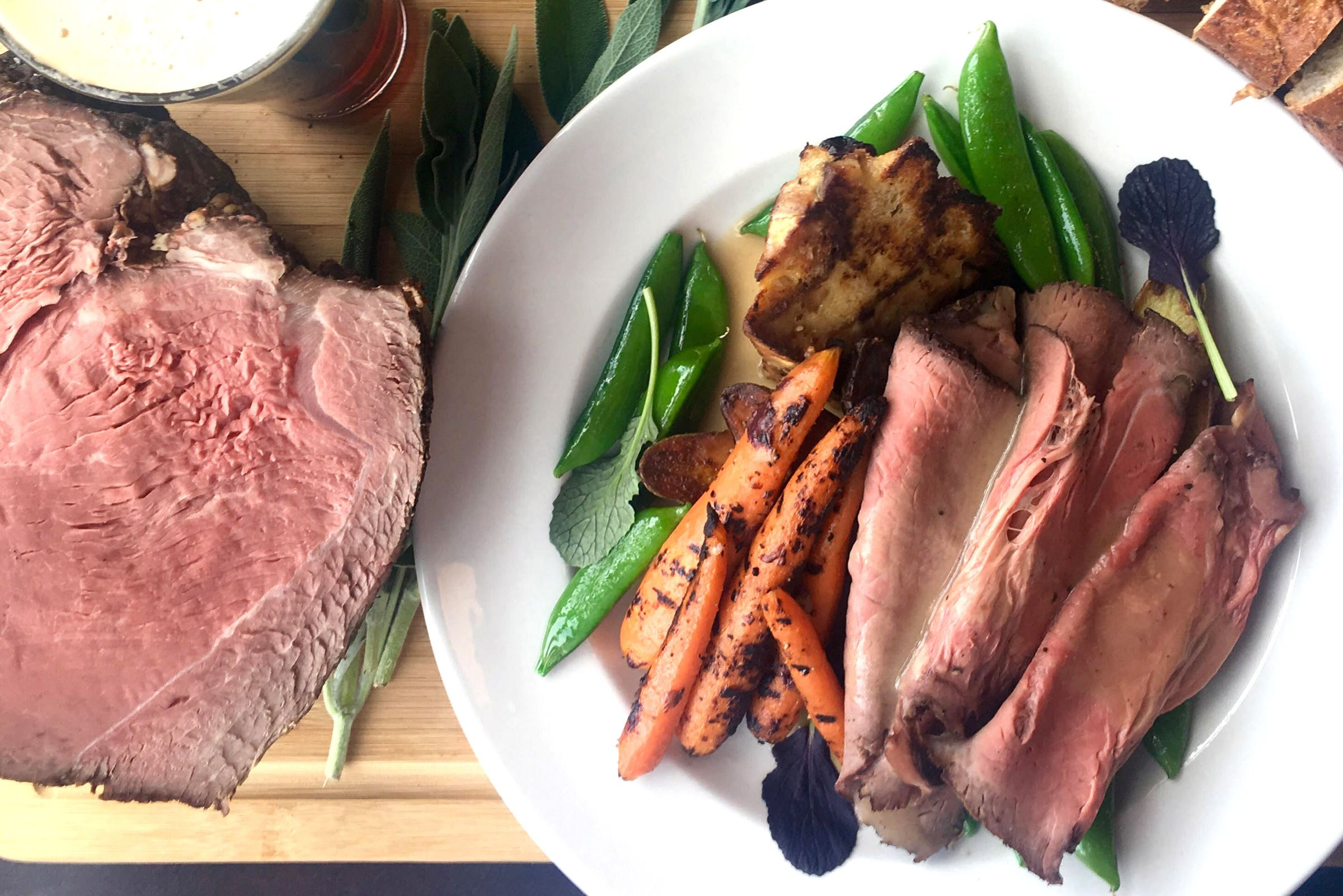 roast block 292 Block 292's roast beef with sugar snap peas, roasted carrots and a wedge of bread pudding at its Sunday Roast.