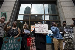 Protesters with Penn Plaza Support and Action Coalition rally against the Penn Plaza demolition in April outside LG Realty Headquarters inside the Oliver Building along Smithfield Street, Downtown