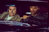 "Ian McShane's Mr. Wednesday hires Ricky Whittle's Shadow Moon to be his bodyguard in ""American Gods."""