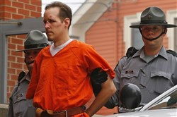 In this Oct. 31, 2014 file photo Eric Frein is escorted by police into the Pike County Courthouse for his arraignment in Milford, Pa.