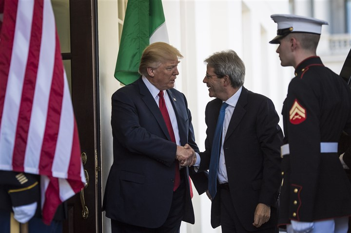 LIBYA-POLICY President Donald Trump greets Italian Prime Minister Paolo Gentiloni Thursday as he arrives outside the West Wing of the White House.